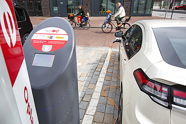 An Ampera electric car at a charging station for electric cars in Ijburg, Amsterdam, Netherlands, Europe