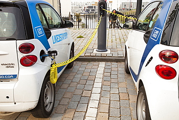 A Smart car at a charging station for electric cars in Ijburg, Amsterdam, Netherlands, Europe
