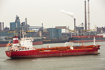 The oil tanker, Spring, importing oil into Holland past the Tata steel plant at Ijmuiden, Netherlands, Europe