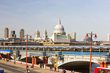 Blackfriars Bridge across the River Thames, the world's largest solar bridge, with St. Paul's Cathedral on the skyline, London, England, United Kingdom, Europe