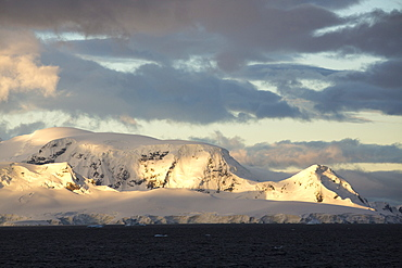 Light on mountainous scenery in Graham Land in Wilhelmina Bay on the Antarctic Peninsular, which is one of the fastest warming places on the planet.