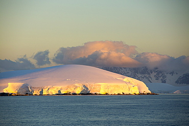 Evening light over mountains from the Gerlache Strait separating the Palmer Archipelago from the Antarctic Peninsular off Anvers Island. The Antartic Peninsular is one of the fastest warming areas of the planet.