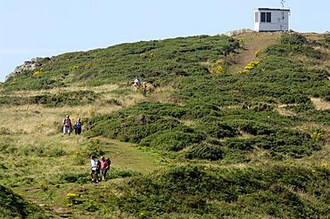 People walking on coast path, Coastguard Hut, Deer Park, Marloes, Pembrokeshire, Wales, UK, Europe