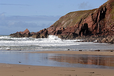 Waves and cliff, West Dale beach, Dale, Pembrokeshire, Wales, UK, Europe