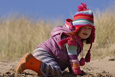Young girl in sand dunes, Broad Haven South, Stackpole, Pembrokeshire, Wales, UK, Europe