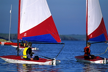 Children learning to sail Toppers, Dale, Pembrokeshire, Wales, UK, Europe