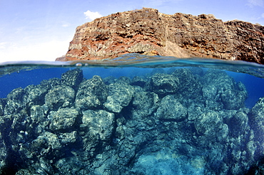 Split image of Lanai and underwater rocks and reef, Lanai, Hawaii, United States of America, Pacific