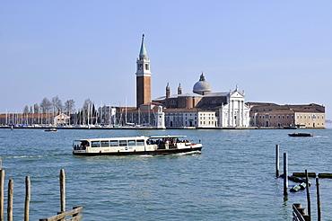 Ferry commutes between Piazza San Marco and San Giorgio Maggiore Island, Venice, UNESCO World Heritage Site, Veneto, Italy, Europe