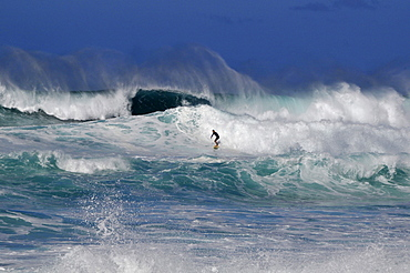 Surfer on wave, Sunset Beach, North Shore, Oahu, Hawaii, United States of America, Pacific