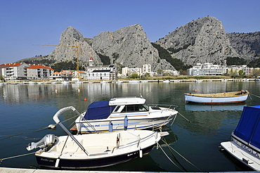 Boats, harbour and cliffs, coastal town of Omis, Croatia, Europe