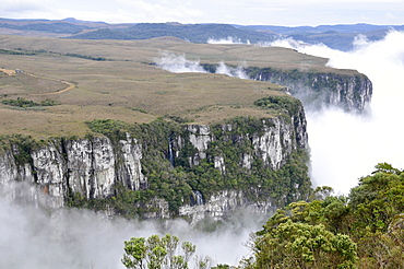 Clouds sweep into Fortaleza Canyon in the early morning, Cambara do Sul, Rio Grande do Sul, Brazil, South America