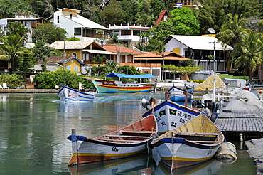 Boats and houses on canal, Fishing village of Barra da Lagoa, Florianopolis, Santa Catarina, Brazil, South America