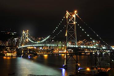 Hercilio Luz bridge at night, connects mainland to island of Florianopolis, Santa Catarina, Brazil, South America
