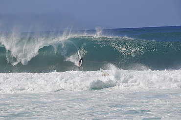 Surfers riding famous barrel waves, Oahu, Hawaii, United States of America, Pacific