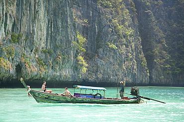 The Cove, tourists sunbathing on boat.  Ko Phi Phi Lee, Krabi, Thailand, Asia