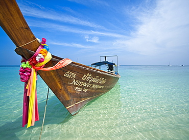 Traditional Thai Long Tail Boat on beach.  Krabi, Thailand, South-East Asia, Asia