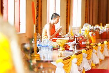 Buddhist monk in prayer in Buddhist Temple, Karon Beach, Phuket Island, Phuket, Thailand, Southeast Asia, Asia