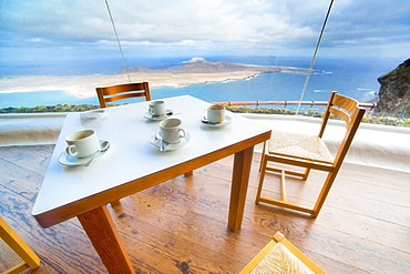 09/04/2009. Spain, España, Canary Islands, Canarias, Lanzarotie, View from Mirador del Rio to La Graciosa island. Cesar Manrique Site of interest, Caffe, coffe, table and chairs. Arrecife, Mirador Del Rio, Lanzarote. Canary Islands, Spain, España