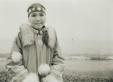 2008; Inuit Settlement with local girl in traditional clothes, Lorino Village (Chukotskiy Peninsular) Russia, Asia.