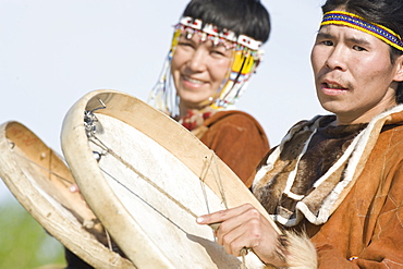 Inuits Male and Female  of the Koryaks peoples in native clothes playing drums, Ossora Village (Koryakskiy Peninsular) Russia, Asia