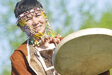 Inuit Female  of the Koryaks peoples in native clothes playing drums, Ossora Village (Koryakskiy Peninsular) Russia, Asia