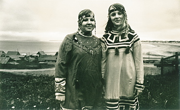 Two local girls, traditional inuit dress, town center of Nikolskoye Village, Bearing Sea, Russia, Asia