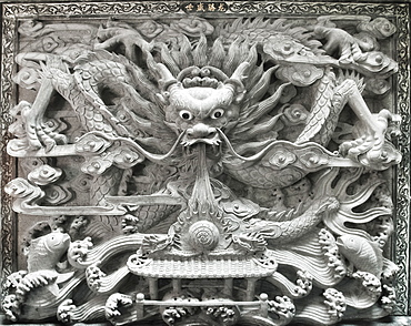 Chinese Temple, Decorative dragon wall carving.  Kuching, Sararwak, Malaysia, Asia