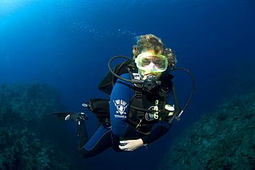 Diver on tropical coral reef and caverns, Maria La Gorda, Cuba, Caribbean