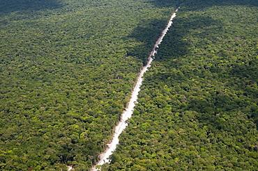 Main highway of Guyana cutting through the rainforest, Guyana, South America