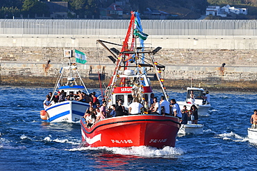 The Virgen del Carmen, wrapped in protective plastic, being carried out to sea from Tarifa, accompanied by a flotilla of boats, Tarifa, Cadiz, Andalusia, Spain, Europe