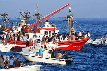 Chaotic scene at sea, as the Virgen del Carmen from Tarifa is taken on an annual ritual voyage with small boats in attendance, Cadiz, Andalusia, Spain, Europe