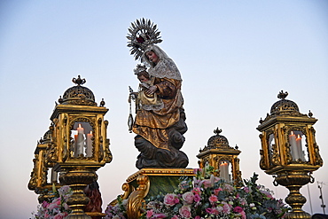 The Virgen del Carmen on her float that will take her to the Santuario near Tarifa in the evening of her excursion to sea, Tarifa, Cadiz, Andalusia, Spain, Europe