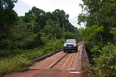 Crossing a bridge on the main highway through Guyana's rainforest, Guyana, South America
