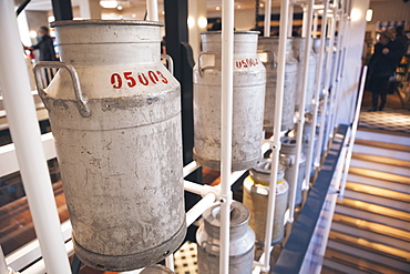 Milk churns in the cheese factory, Volendam, North Holland Province, The Netherlands (Holland), Europe