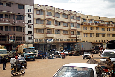 One of the streets in the commercial centre of Kampala.  One of the most concentrated areas in the City with narrow streets and high buildings. Kampala, Uganda, East Africa