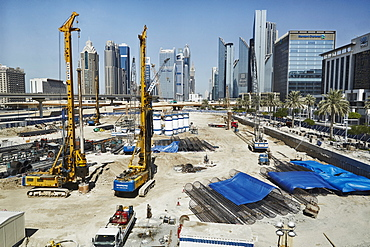 Construction is all around The Burj Khalifa, the worlds tallest building in downtown Dubai, United Arab Emirates, Middle East