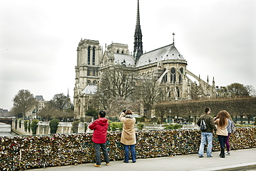 The Love Lock bridge (Pont de l'Archeveche) looking out to Notre Dame, Paris, France, Europe