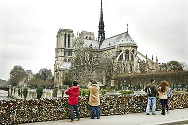 The Love Lock bridge (Pont de l'Archeveche) looking out to Notre Dame, Paris, France, Europe