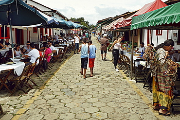 Street lined with outside restaurants in the old town of Pirenopolis, in the Brazilian state of Goias, Brazil, South America