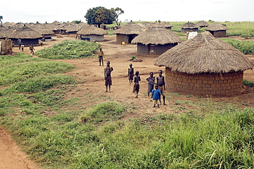 An IDP camp (internally displaced people) in Amuru district of Northern Uganda has been created to accommodate the mass of Ugandan refugees fleeing the LRA (Lords Resistance Army) who are fighting the Ugandan government and its people.  Accommodation are basic mud huts, but always well kept. Amuru, Uganda, East Africa
