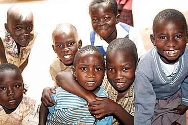 Young residents enjoy smiling in front of camera, Gulu Town, Northwest Uganda. Gulu Town, Uganda, East Africa