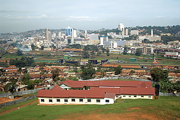A view of the Kampala skyline with it's rail track and industrial buildings in the foreground.  This is Kampala's Central Business District. Kampala, Uganda, East Africa