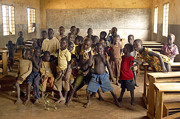 An IDP camp (internally displaced people) in Amuru district of Northern Uganda has been created to accommodate the mass of Ugandan refugees fleeing the LRA (Lords Resistance Army) who are fighting the Ugandan government and its people.  Inside one of the classrooms, the children are more interested in the camera than study. Amuru, Uganda, East Africa