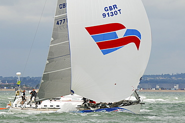 Action dropping the Spinnaker at Skandia Cowes Week 2008 Finish Line