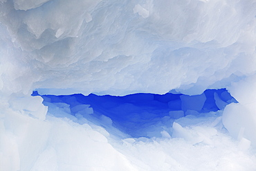 Detail of an intensely blue iceberg adrift in Antarctica.