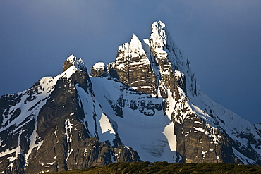 Sunset on snow-capped mountain peaks that are a part of the Andes Mountains just outside Ushuaia, Argentina.