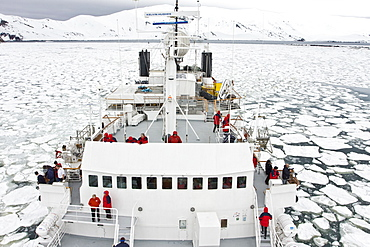 The Lindblad expedition ship National Geographic Endeavour operating in shre fast ice in Port Foster within the caldera at Deception Island, South Shetland Island Group, Antarctica.