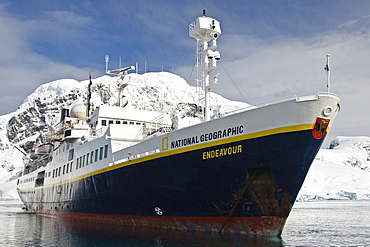 The Lindblad expedition ship National Geographic Endeavour operating with it's fleet of Zodiacs in and around the Antarctic peninsula, Antarctica.