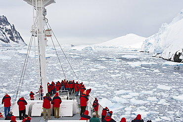 Views of the scenic Lemaire Channel on the west side of the Antarctic peninsula in Antarctica. Shown here is the National Geographic Endeavour navigating the channel through ice floes in late spring.