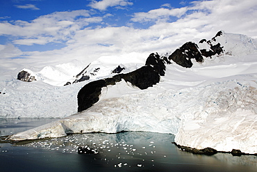 Snow and ice covered mountains in Paradise Bay on the Antarctic Peninsula.